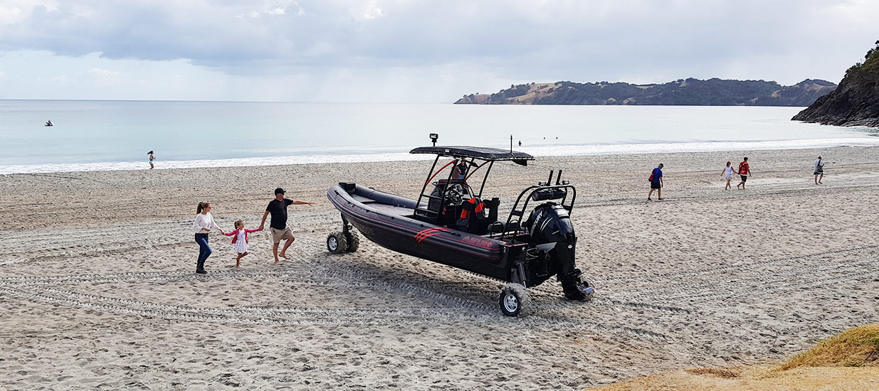 8.4m-ASIS-Amphibious-family-boat-parked-on-beach-NZ